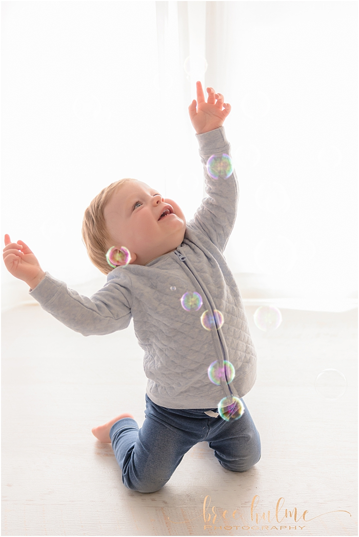 Sydney's best child photographer, Bree Hulme Photography on Sydney's Northern Beaches and North Shore . Popping bubbles is full of joy.