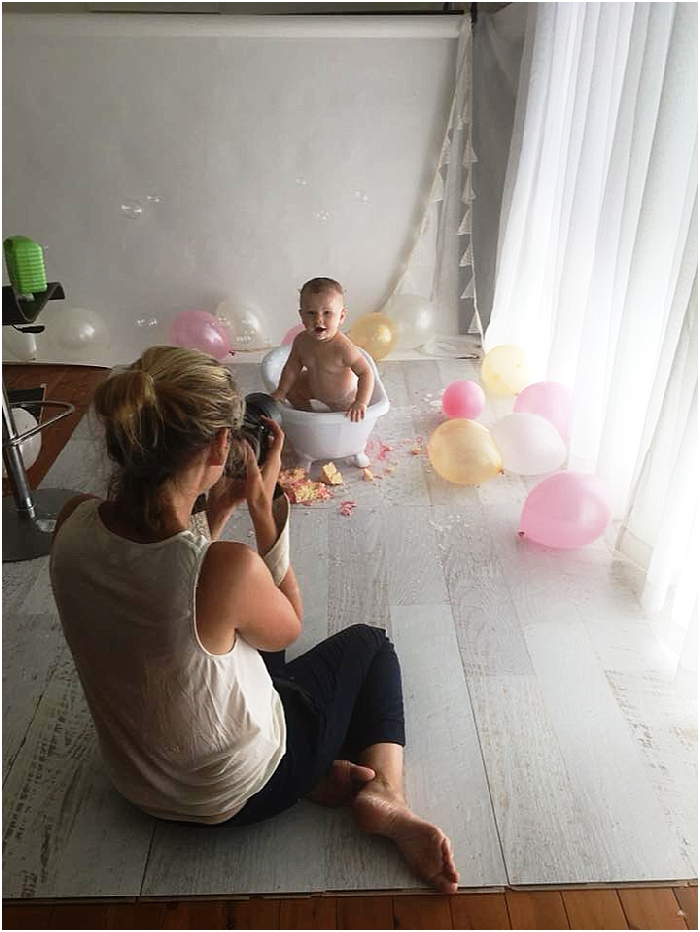 Behind the scenes of a cake smash portrait session at Bree Hulme Photography